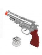 Pistolet argenté avec plaque de police